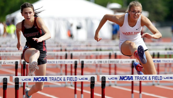 Fond Du Lac's Brooke McDowell, left, and Racine Horlick's Grace Tempesta compete in the 100-meter hurdles Friday during the first day of the WIAA state track and field meet in La Crosse.