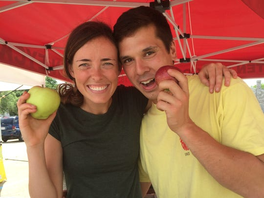 Drew Ten Eyck, here with girlfriend Megan Haserodt, returned to his family's orchard.