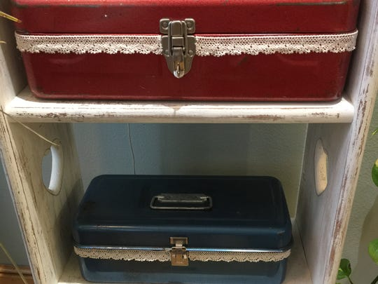 Upcycled tool cases-turned-craft boxes are sold at