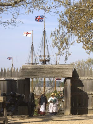 Two historical interpreters walk into the fort at Jamestown settlement in Jamestown, Va., in 2006. Thousands of archaeological sites, including Jamestown, will be underwater by 2100 if seas continue to rise.