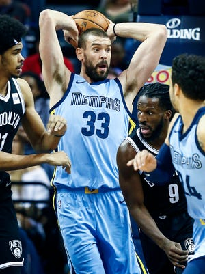 Memphis Grizzlies center Marc Gasol (middle) grabs a rebound against Brooklyn Nets during first quarter action at the FedExForum in Memphis, Tenn., Sunday, November 26, 2017.