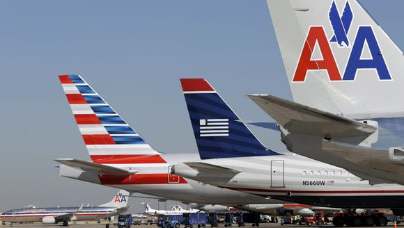 American Airlines and US Airways planes at gates at