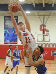 Cooper's Deven Bailey (23) grabs a rebound over a San
