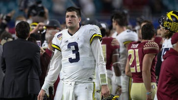 Michigan quarterback Wilton Speight  walks off the field after losing to Florida State, 33-32, in the Orange Bowl on Dec. 30, 2016, at the Hard Rock Stadium in Miami Gardens, Fla.