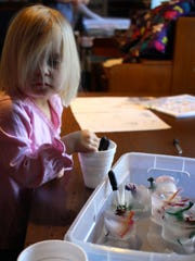 Delia Melssen, 2, excavates some dinosaurs from the ice at the Ida Rupp Public Library.