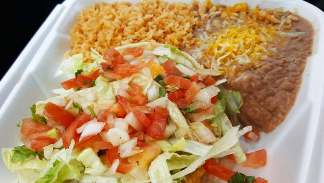 Fish tacos combination plate ($6.60) from Fidencio's Mexican Food comes with a side of rice and beans.