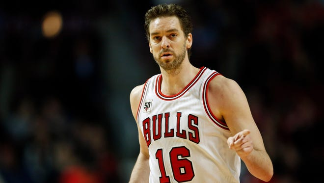 Pau Gasol reacts after scoring against the Sacramento Kings during the second half at United Center.
