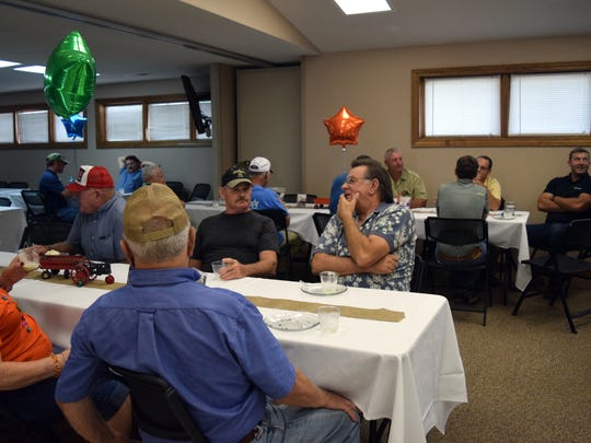 Large group of farmers and community leaders in attendance for his retirement reception.