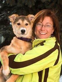 Kim Slade with an Alaskan Husky.