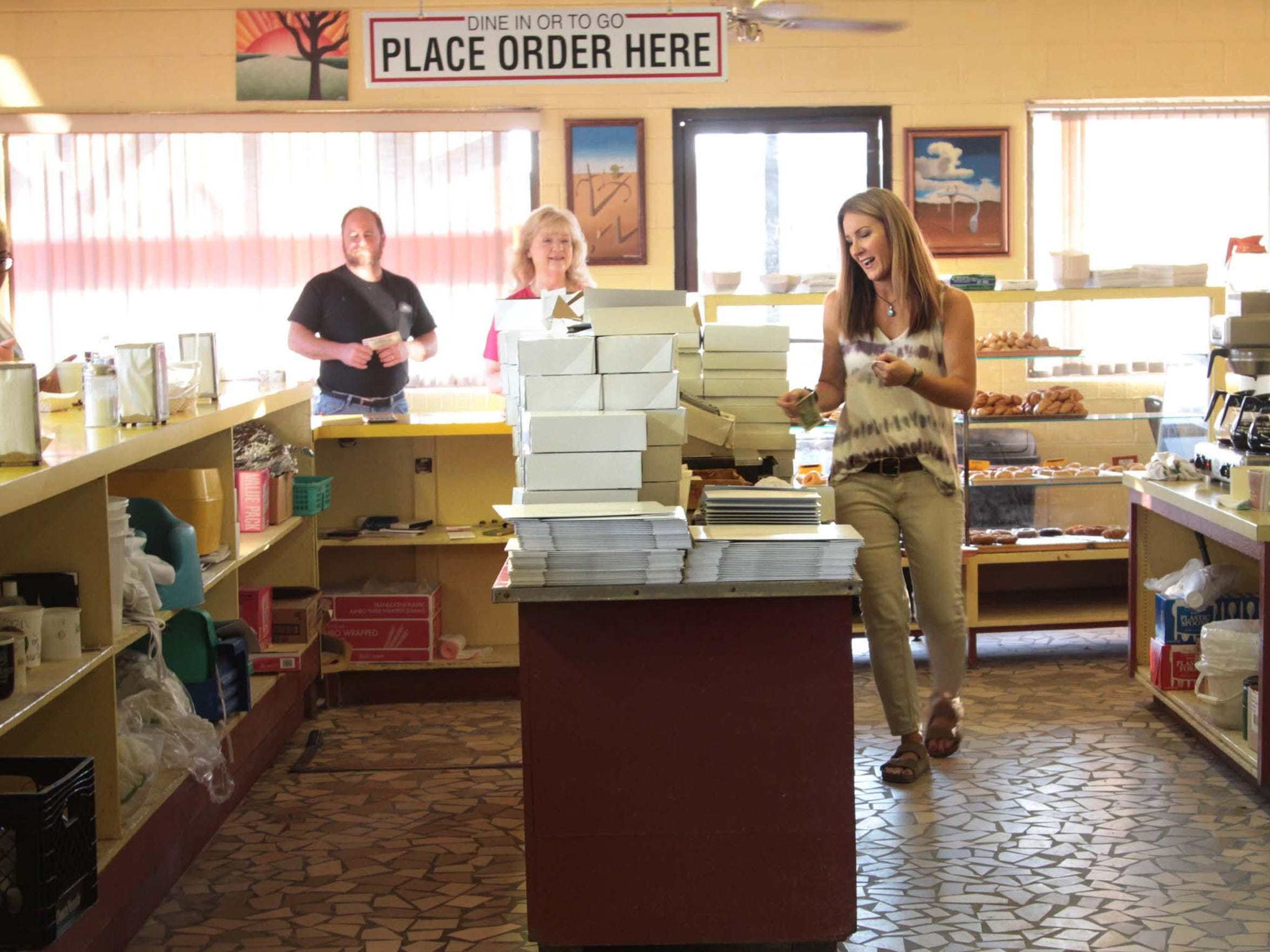 Beth Freeman Risinger mans the front counter during