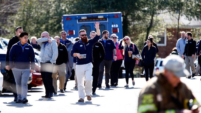 Lester Glenn Chrysler / Dodge / Jeep employees are evacuated from the dealership on Route 37 Eastbound in Toms River Wednesday, February 14, 2018.  It was evacuated when some employees were overcome by fumes.
