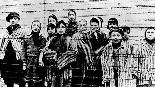 A picture taken just after the liberation by the Soviet army in January, 1945, shows a group of children wearing concentration camp uniforms behind barbed wire fencing in the Auschwitz Nazi concentration camp. More than a million Jews died in the infamous Nazi death camp, but on Jan. 27, 1945, only a few thousand sickly inmates remained at the most vivid symbol of Nazi cruelty after most were marched off to die elsewhere. Now, 70 years later, as the world marks International Holocaust Remembrance Day, Marta Wise is one of the few remaining survivors who were actually there when the terror in Auschwitz finally ended.