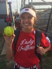 North DeSoto's Sydney Webster holds up one of her home run balls.