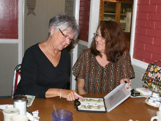 Sara Thorne (left) of Flippin and Wendy Luna of Gassville,