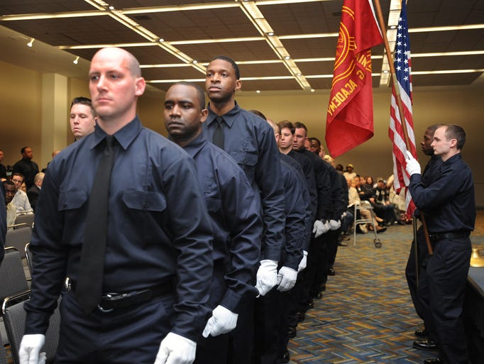 Detroit Fire Department basic training graduates march