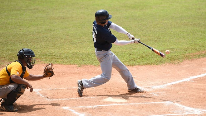 C-Men'z batter Darrlye Masnayaon connects with the ball during a 2018 Guam Masters Baseball League game at Paseo Stadium on June 23, 2018.