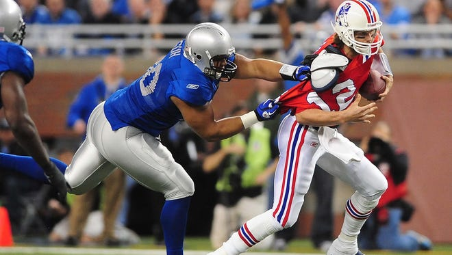 New England Patriots quarterback Tom Brady (12) gets sacked by Detroit Lions defensive tackle Ndamukong Suh (90) during the first quarter at Ford Field.