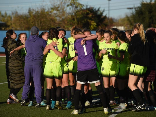 The Rhinebeck girls soccer team celebrates after winning the Section 9 Class B final against Spackenkill at Middletown High School.