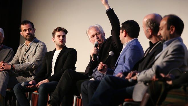 International filmmakers Claude Barras, left, Xavier Dolan, Hannes Holm, moderator Scott Feinberg, Erik Poppe and Asghar Farhadi participate in a panel discussion at the Mary Pickford Theater in Cathedral City during the Palm Springs International Film Festival.