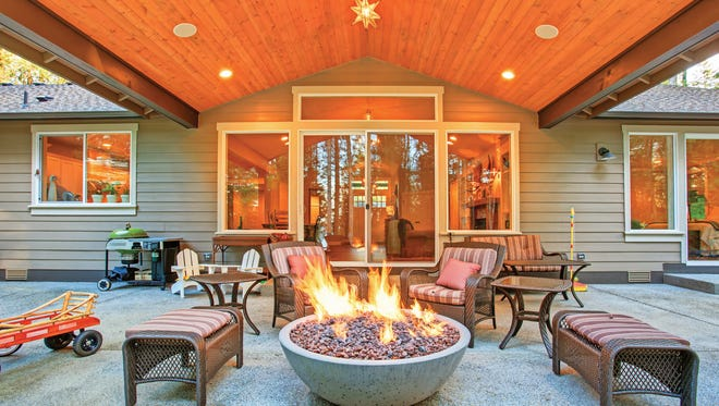 A fire pit in a backyard space can provide warmth as well as an invitation for people to gather.
