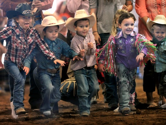 Children race to the center of the Griffin Arena for