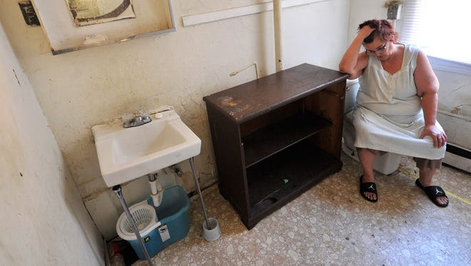 'You have to fight to get in to use your own bathroom,' said resident Lisa Kelly of the shared bathroom in the rooming house she lives in on the 600 block of West Market Street. Kelly and other people who live in the apartment have until June 1 to move out after a York County judge ordered the property's owner, Alfred Riccio, and the City of York to evict residents from the building's 15 rooms.