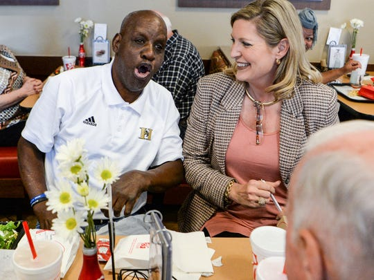 James Robert Radio Kennedy, left, sings happy birthday with Lisa McWherter of Anderson during his 71st birthday party at Chick Fil A on Greenville Street in Anderson on Tuesday.