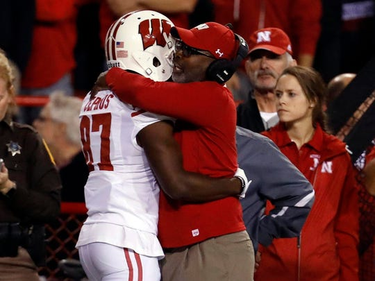 Badgers wide receiver Quintez Cephus celebrates a touchdown with wide receivers coach Ted Gilmore.