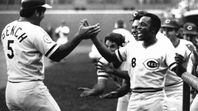 Joe Morgan, Pete Rose and other Reds teammates welcome Johnny Bench back to dugout after a home run against the Phillies in the 1976 National League Championship Series.