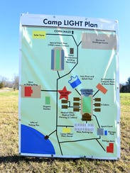 A map displayed along the road on the camp's property