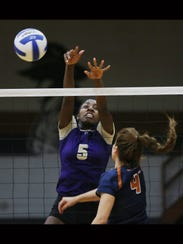 Burges' Arielle Mack deflected a shot by Riverside's