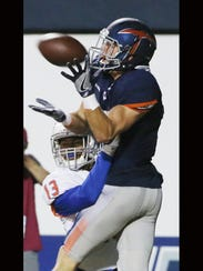 UTEP receiver Cole Freytag leaps over Houston Baptist