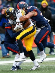 Akrum Wadley of the Iowa Hawkeyes runs the ball and