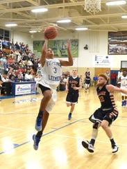 Robert E. Lee's Jayden Williams takes the ball up and