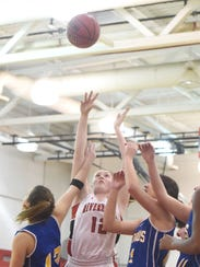 Riveheads' Emma Casto shoots for two points during