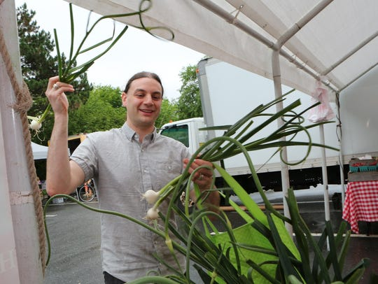 Mike Zollner from Port Chester checks out the garlic
