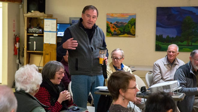 Richard Kadzis talks to a group of about 30 people at the Southwest Environmental Center about his experience in radio at an open house meeting to discuss the launch of new community radio station KTAL-LP.