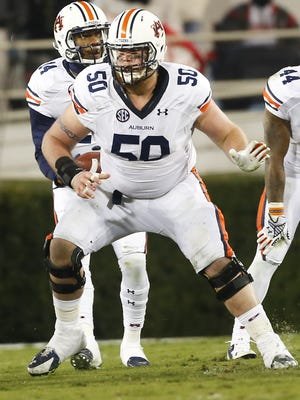 Auburn center Reese Dismukes will make his 50th and final start in the Outback Bowl.