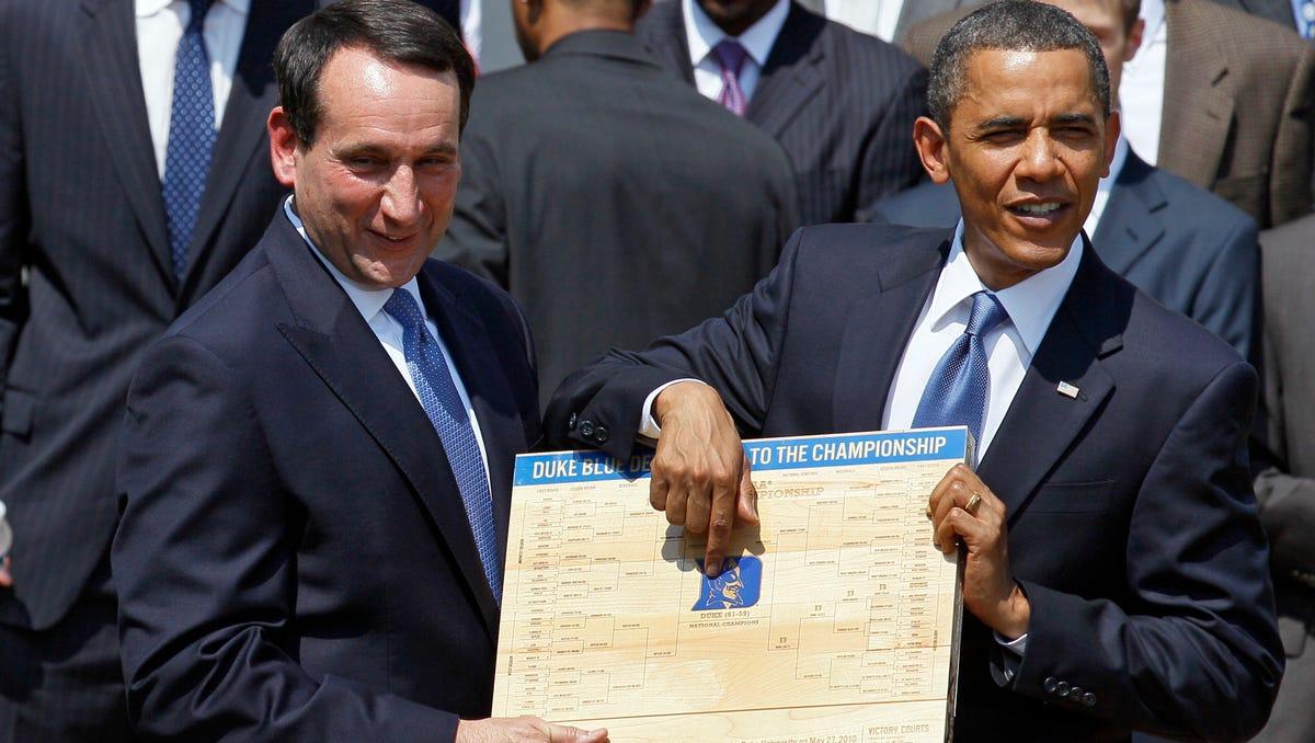 Former President Barack Obama looks over the bracket with Duke coach Mike Krzyzewski.