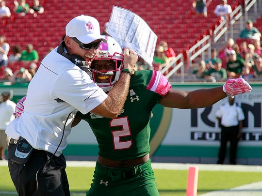 South Florida DB Jamie Byrd (2) is congratulated by