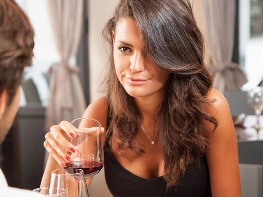 Young woman with red wine at restaurant