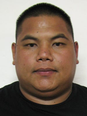 Edward Crisostomo, Department of Corrections officer, is shown in his booking mugshot taken Aug. 24.