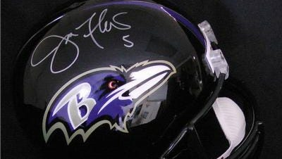 This autographed Baltimore Ravens helmet signed by quarterback Joe Flacco is one of 50 items being auctioned by the Delaware Small Business Chamber.