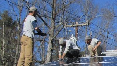In this file photo, a work crew from Sugar Hollow Solar installs solar panels on the roof of First Congregational United Church of Christ in Laurel Park.