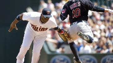 Minnesota Twins first baseman Kenny Vargas (19) tags Cleveland Indians catcher Yan Gomes (10) during the fifth inning at Target Field.