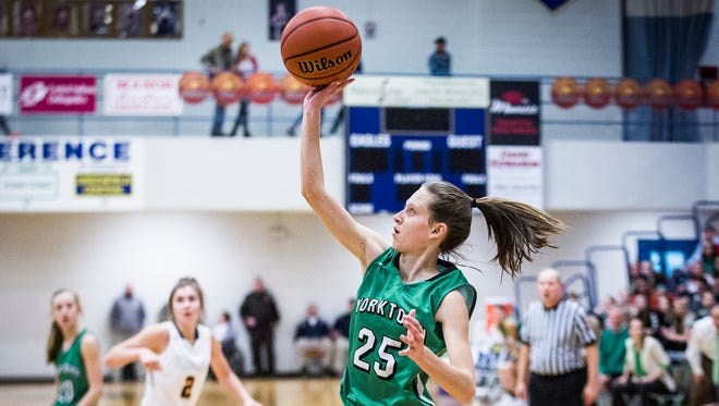 Yorktown's Elizabeth Reece shoots past Delta's defense during the county championship last season. After a big freshman season, Reece will be relied on heavily once again.
