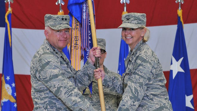 U.S. Air Force Col. Jennifer Reeves, right, accepts command of the 341st Missile Wing from Maj. Gen. Fred Stoss, 20th Air Force commander, as Chief Master Sgt. Amber Mitchell, 341st MW guidon bearer, looks on during a change of command ceremony at Malmstrom Air Force Base on June 19. Reeves' previous assignment was 381st Training Group commander, Air Education and Training Command, at Vandenberg AFB, Calif. The 341st Missile Wing, headquartered at Malmstrom AFB, is one of three U.S. Air Force bases that maintains and operates the Minuteman III intercontinental ballistic missile.