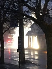 Downed wires caused an early morning fire on Main Street