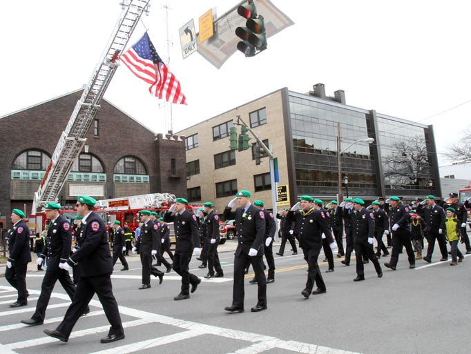 White Plains firefighters proudly march past their