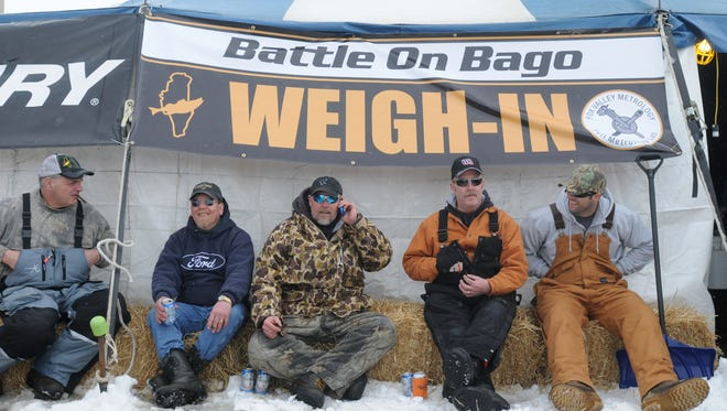 Kevin Welch, left, Dennis Loertscher, Jeff Pomplun, Rick Stanton and his brother, Ryan,wait at the weigh-in tent during the  Battle On Bago ice fishing tournament in 2014. If conditions don't allow for the ice fishing portion of the festival, organizers say the rest of the event will go on as planned.